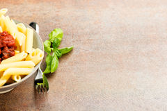 Penne pasta with a tomato bolognese beef sauce Royalty Free Stock Images