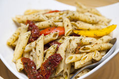 Penne pasta. In tomato sauce with chicken, tomatoes Royalty Free Stock Photo