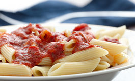Penne pasta in tomato sauce closeup Stock Photo
