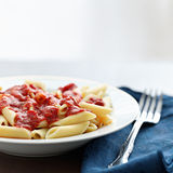 Penne pasta in tomato sauce with copyspace Royalty Free Stock Image