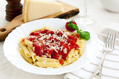 Penne pasta with tomato sauce and parmesan cheese Royalty Free Stock Images