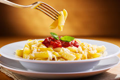 Penne pasta with tomato sauce stock photography