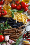 Penne pasta with vegetables,  herbs and olive oil Stock Photos