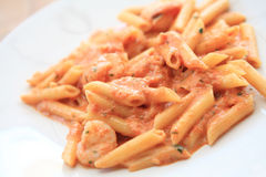 Penne pasta with vodka tomato sauce and shrimp Royalty Free Stock Photos