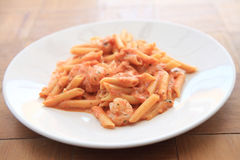 Penne pasta with vodka tomato sauce and shrimp Stock Image