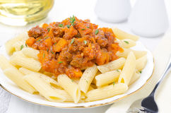 Penne Pasta With Sauce Of Beef, Tomato And Pumpkin Close-up Royalty Free Stock Photos
