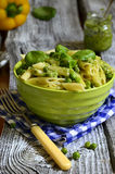 Penne with pesto and green peas. Stock Photo