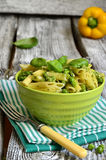 Penne with pesto and green peas. Royalty Free Stock Images