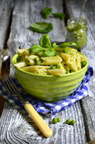 Penne with pesto and green peas. Royalty Free Stock Photography