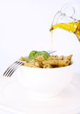 Penne with pesto and olive oil Stock Images