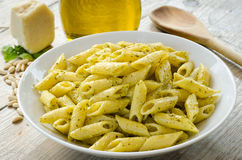Penne with pesto sauce Stock Photo