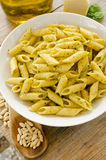 Penne with pesto sauce Stock Photos