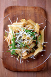 Penne with pickled peppercorns and capers Stock Photography