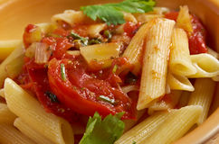 Penne rigata with marinara sauce Stock Photos