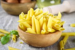 Penne rigate. Macaroni in the form of feathers. mostaccioli pasta. Royalty Free Stock Photography