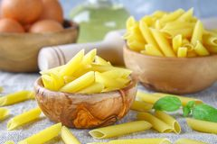 Penne rigate. Macaroni in the form of feathers. mostaccioli pasta. Stock Photo