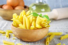 Penne rigate. Macaroni in the form of feathers. mostaccioli pasta. Royalty Free Stock Photos