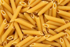 Penne rigate pasta background Stock Photo