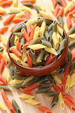 Penne rigate pasta in a bowl. Close-up Stock Image