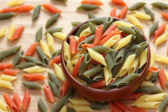 Penne rigate pasta in a bowl. Close-up Stock Photo