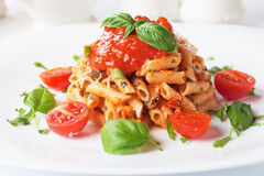 Penne rigate pasta with tomato sauce Stock Photography
