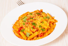 Penne rigate pasta with tomato sauce Stock Photo