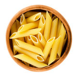 Penne rigate pasta in wooden bowl over white Royalty Free Stock Image