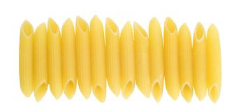 Penne rigate in a row Royalty Free Stock Image