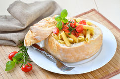 Penne rigate with tomato sauce Stock Images