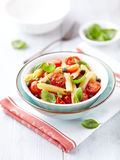 Penne with roasted cherry tomatoes and capers Stock Photography