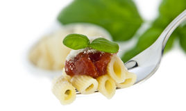 Penne with sauce and chese on a fork Stock Images