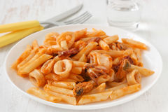 Penne with seafood stock images