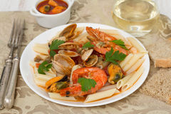 Penne with seafood Stock Photos