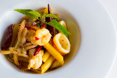 Penne with spicy seafood basil sauce Stock Images