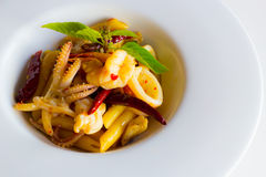 Penne with spicy seafood basil sauce Stock Photos