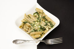 Penne with spinach in cheese sauce Royalty Free Stock Images
