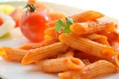 Penne with tomato Stock Images