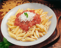 Penne with tomato sauce. Royalty Free Stock Photos