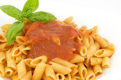 Penne with tomato sauce and basil Royalty Free Stock Image