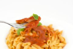 Penne with tomato sauce and basil Royalty Free Stock Photos