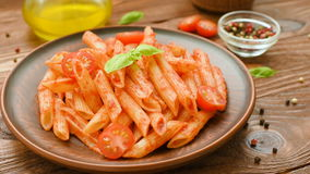Penne with tomato sauce, basil and tomatoes stock video