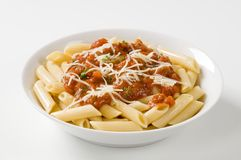 Penne with tomato sauce and cheese Stock Photos