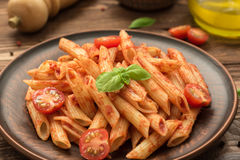 Penne with tomato sauce, fresh basil and tomatoes Royalty Free Stock Images