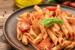 Penne with tomato sauce, fresh basil and tomatoes Stock Images