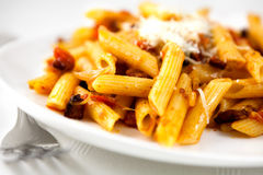 Penne with tomatoes,pancetta and parmesan Stock Images