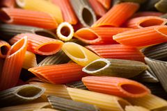 Penne tricolore pasta. Closeup of penne tricolore pasta Royalty Free Stock Image