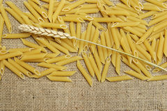 Penne and wheat ear Royalty Free Stock Images