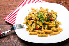 Penne with zucchini Stock Images