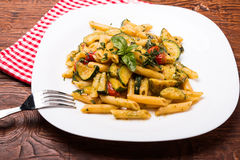 Penne with zucchini Stock Photos