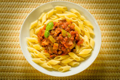 Penne with zucchini and tomato sauce Stock Images
